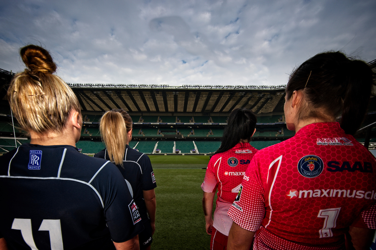 Army and Royal Navy Women look out from tunnel at Twickenham Stadium